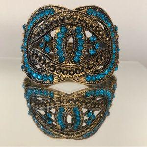 Blue rhinestone hinged cuff